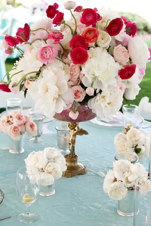 """.Like the red from the top flowers but I don't know what they are! I like the mix of big and smaller flowers but the general arrangement is too much like a """"big ball"""" (and I hate the candelabra beneath...)"""