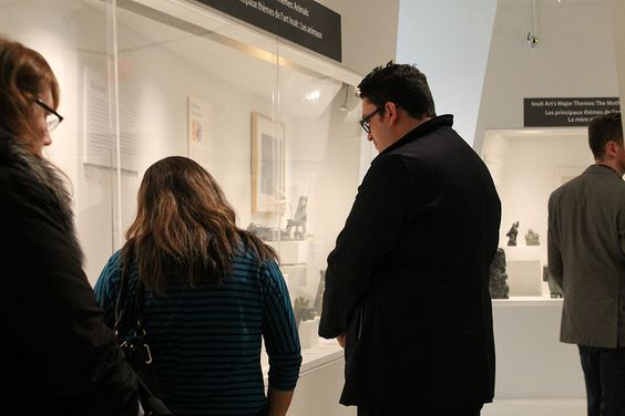 NACA (Nunavut Arts and Crafts Association) visitors taking a guided tour led by MIA Associate Curator Alysa Procida.