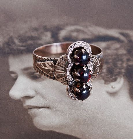 Garnet Trio Ring with Feathered Setting. $495