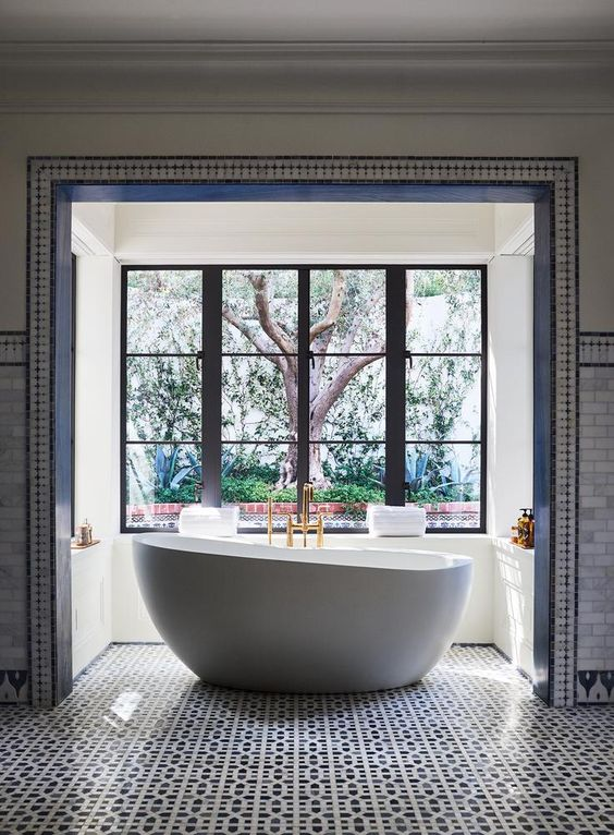 <strong>SOAK IT UP</strong>| the master bathroom features custom…
