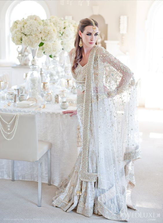 White bridal #lengha - Visit http://www.yourdreamshaadi.co.uk for all the advice, inspiration and supplier contacts you need to plan your dream #asianwedding