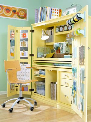 """An old armoire becomes a sewing / crafts space that is easy to """"clean up"""" by simply closing the doors."""