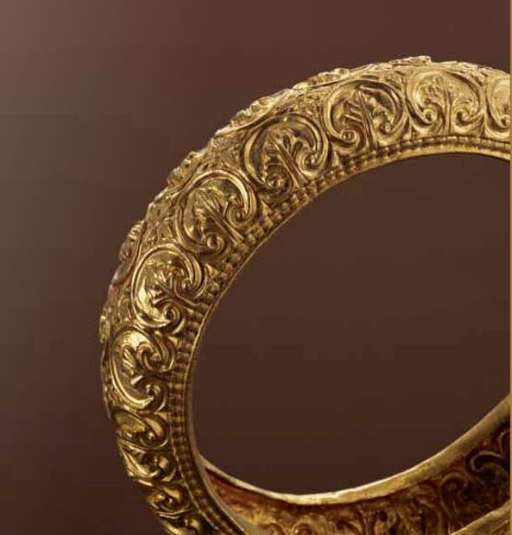 Late Roman gold bracelet, with rosettes and masks, 3rd century A.D.