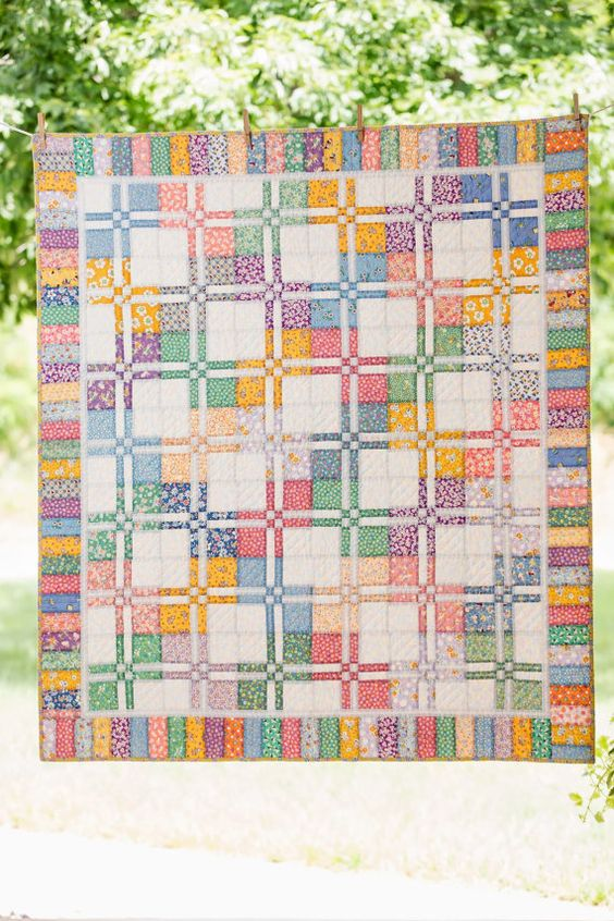 Handcrafted Disappearing Four Patch Quilt by NorahJanes on Etsy