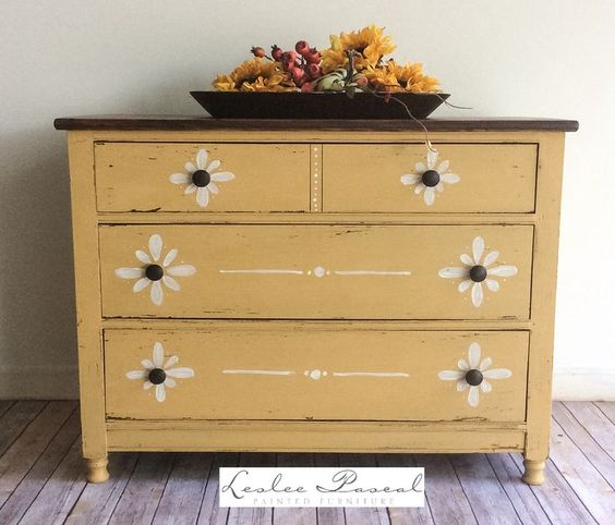 Bachelor's Chest painted in MMS Mustard Seed Yellow milk paint. The decorative detailing is hand done. The top is stained and it's all finished in hemp oil.
