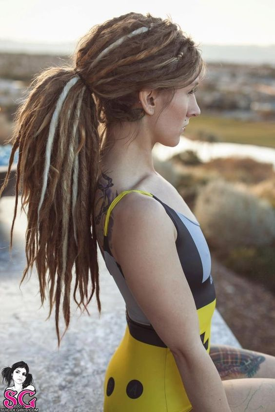 It seems she has a mix of real and fake dreads. I like it! Should probably do this with mine