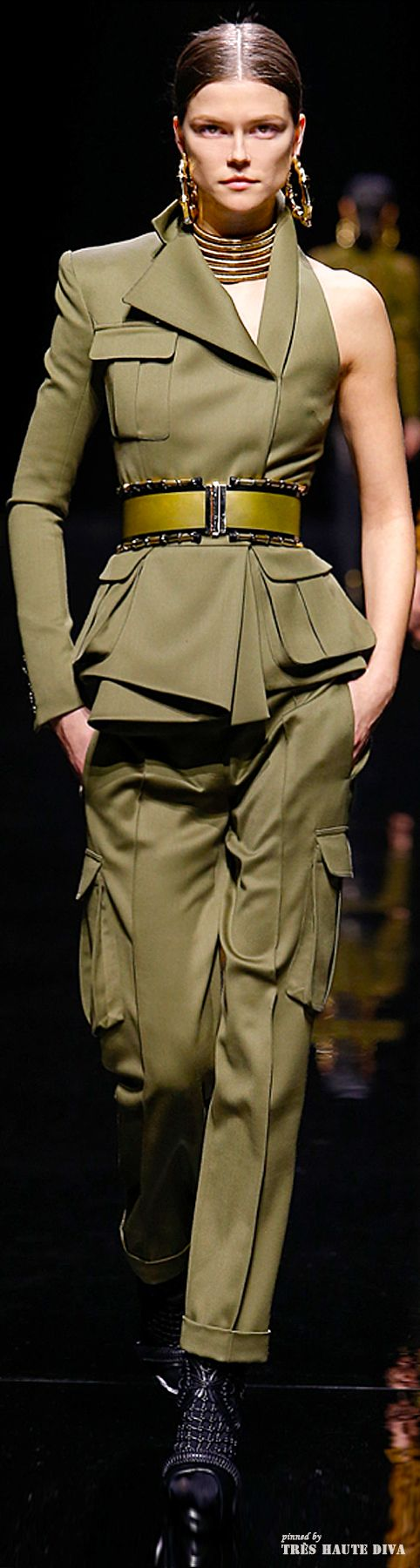 This design has clear military inspiration. The placement of the pockets is very similar to the placement on military garments. The color of this garment is military green. This garment varies from that of a historic military uniform because of the asymmetric design. Pinned by Bethany R. 2/29 group 4