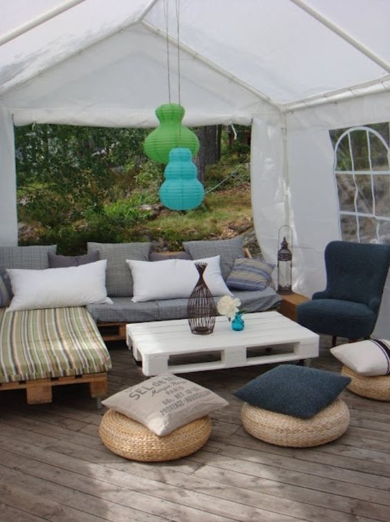 Pallet sofas and used tire ottomans, cover with cushions.