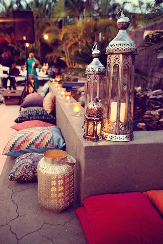 Create a Marrakech themed #soiree with patterned pillows and detailed lighting