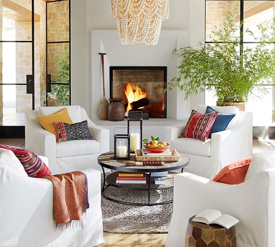 Casual coastal Cali style in a space with white club chairs arranged in conversational arrangement near raised fireplace. #redwhiteblue #interiordesign #cozy #summerstyle
