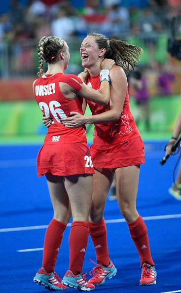 Lily Owsley and Giselle Ansley of Great Britain celebrate victory after the…