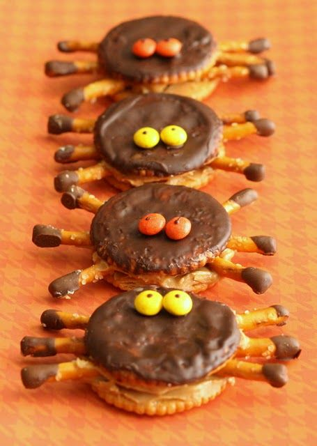 Halloween Spiders -  spread peanut butter on a Ritz cracker; insert pretzel sticks with tips dipped into chocolate coating into peanut butter to form legs; cover with another Ritz; frost top with chocolate coating; add M eyes with dot of chocolate (photo inspiration)