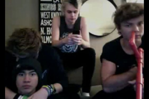 So much going on in this pic. Luke and Calum are hugging. Michaels on his phone and Ashton has a marshmallow shooter.