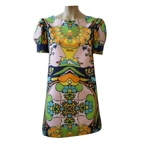 Peter Max Micro-Mini in Op-Art Print  USA    A great and collectible example of Peter Max's fashion from the 60's in a great op-art print! Short puff sleeves baby doll style!    Condition*  Excellent    Period Search  1960's