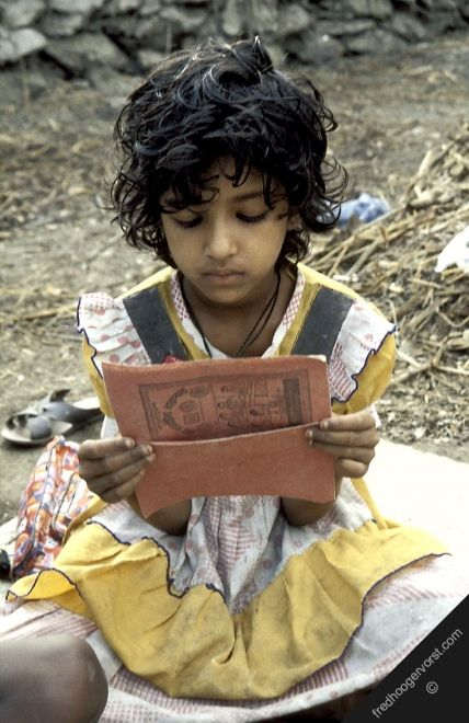 girl child pupils children bangladesh sathkira education reading book schoolclass open-air vertical: