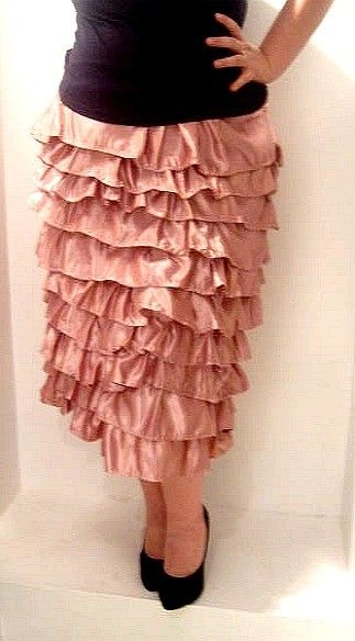 I WANT THIS!! Ruffle skirt...but I'm afraid it would make me look like a gigantic brush from the carwash...