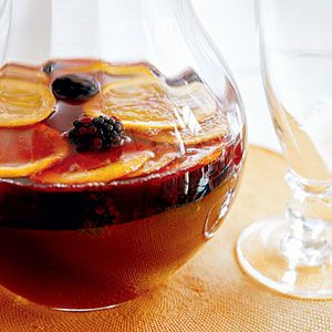 Red Wine Sangria: 1 bottle Rioja or other light- or medium-bodied red wine, 2 cups lemonade, 2 tablespoons sugar, 1 ounce (2 tablespoons) brandy (optional), 1 navel orange, thinly sliced 1/2 pint large, plump blackberries, and 1 cup club soda.