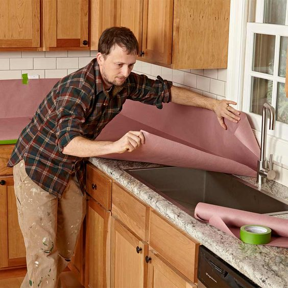 Protect Countertops With Rosin Paper - Painting cabinets is a messy job, and the last thing you want is paint all over your countertops. An easy way to protect your countertops, backsplash and floor is to cover them with inexpensive rosin or brown builder's paper. A common roll size is 35-in.-wide by 140-ft.-long. When you're done in the kitchen, you'll have plenty of paper left for future painting projects.