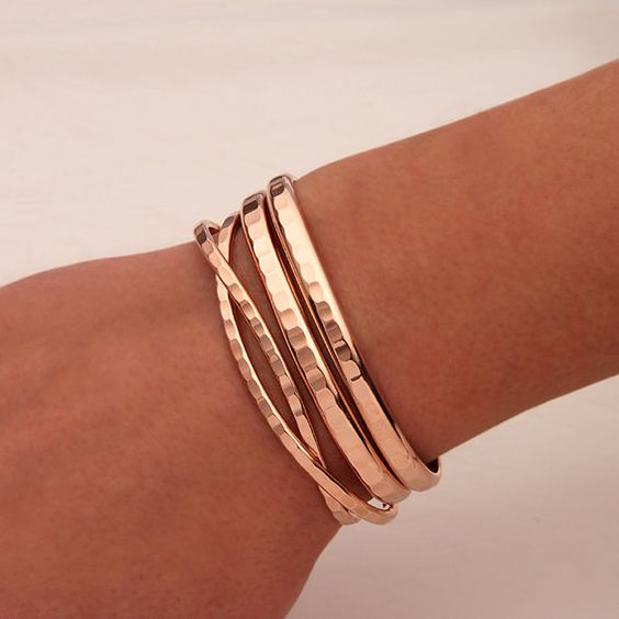 This is a beautiful set of rose gold bracelets. These bracelets all have a deep rich hammer blow that catches the light nicely. The thin cuffs