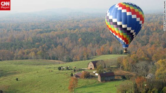 """Ginger Gill Mullins took a photo of this hot air balloon during her own balloon trip over Charlottesville, Virginia. """"It was so awe-inspirin..."""