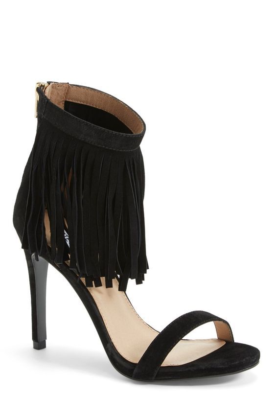 Sweeping fringe twists and turns with every step on this ever-so-chic Steve Madden sandal.