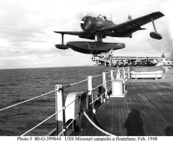 """Missouri (BB-63) catapults a Curtiss SC-2 """"Seahawk"""" floatplane, piloted by Ensign F.H. Gilkie. Photo is dated 27 February 1948."""