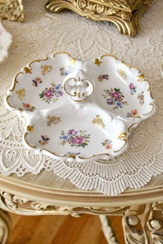 This listing is for one beautiful vintage handled porcelain dish made in Germany. Lovely scalloped edges with gold detail. Three sections with