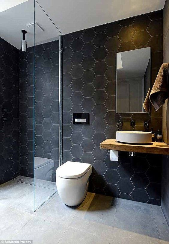 Love the big hex tile on the wall (in a lighter color--maybe white with some yellow and spring greens scattered in)