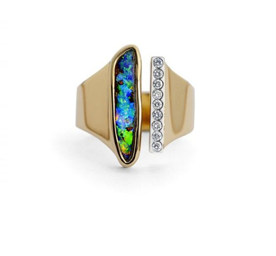 Boulder Opal and Diamond Ring. A spectacular boulder opal with flashes of green, blue, yellow and red, set in 18ct yellow gold, and a run of diamonds in 18ct white gold. David Fowkes Signature Opal Collection.   via dfjewellery.co.uk