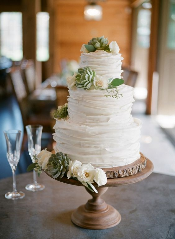 Ruffle wedding cake with succulents