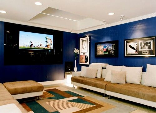 Arrangement of couches, color of blue walls w/ tan/white couches & white ceiling..