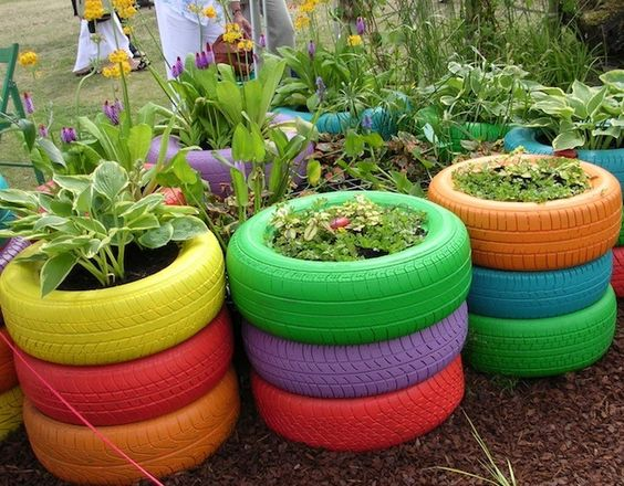 Painted tyre planters for playground. This would look good at an elementary school as well