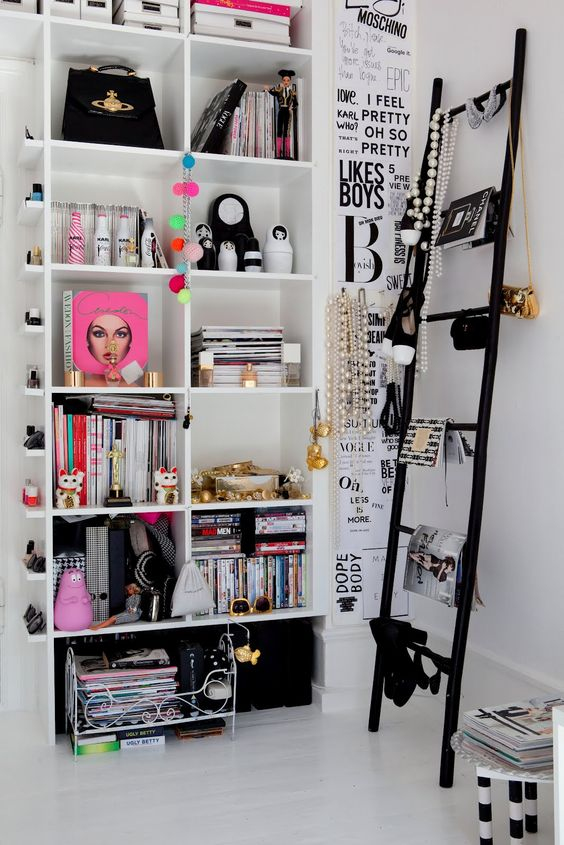 Love everything about this!  A great little closet corner - the tiny shelves for nail polish on the side, the necklace hangers, the ladder with shoes!