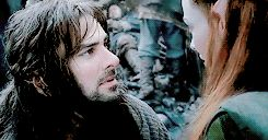 """(gif set) - Tauriel: """"They are your people. You must go."""" Kili: """"Come with me. I know how I feel and I'm not afraid. You make me feel alive. Tauriel... Amrâlimê."""" Tauriel: """"I don't know what that means."""" Kili: """"I think you do."""""""