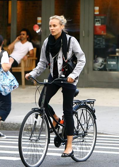 How to look cute while riding a bike.. Diane Kruger pulls it off nicely!
