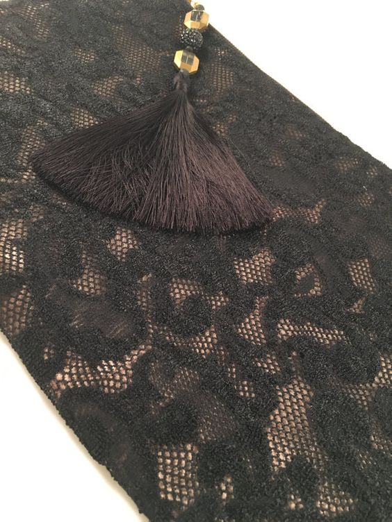 Fabulous oversized clutch in black lace layered over champagne lining. - cooper & oliver