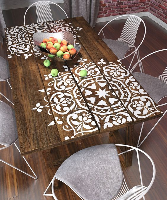 Stenciling a wooden table can add beautiful detail and interest. | Deloufleur Decor & Designs | (618) 985-3355 | www.deloufleur.com: