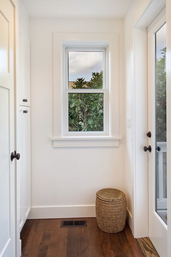 Cottages hallways and house tours on pinterest for Modern window trim