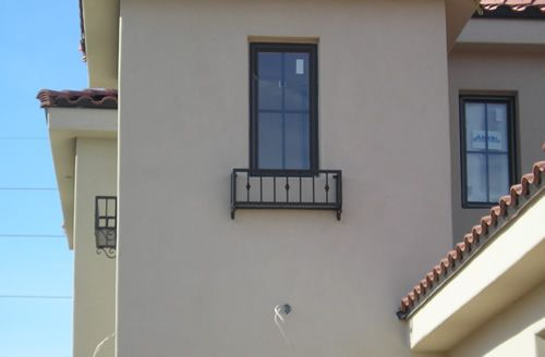 Custom wrought iron used as architectural feature on residential home