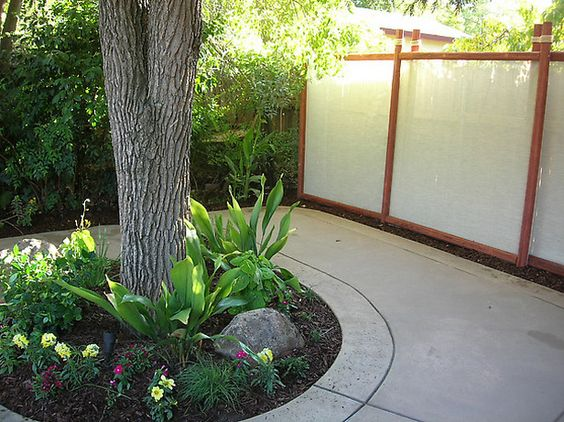 How to make a decorative fabric fence landscape fabric for Decorative fences for backyards
