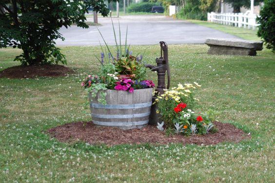 Barrel planter and old pump go together.