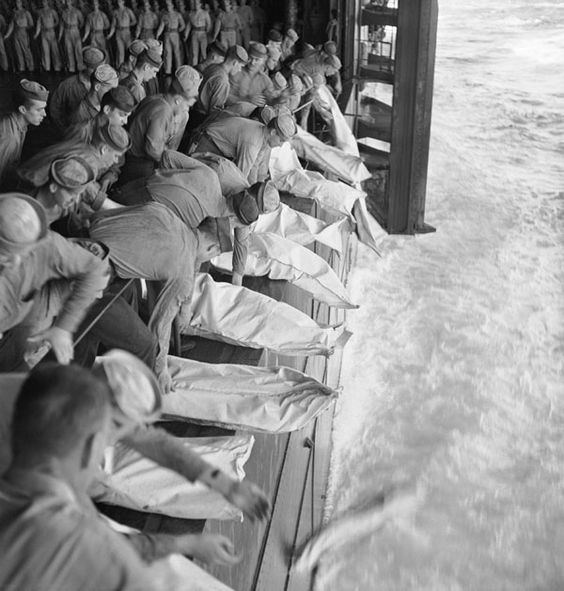 """Burial at sea for the officers and men of the USS Intrepid (CV-11) who lost their lives when the carrier was hit by Japanese bombs during operations in the Philippines."" By Lt. Barrett Gallagher, November 26, 1944"