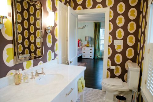 Bright yellow print wallpaper with white and dark floors