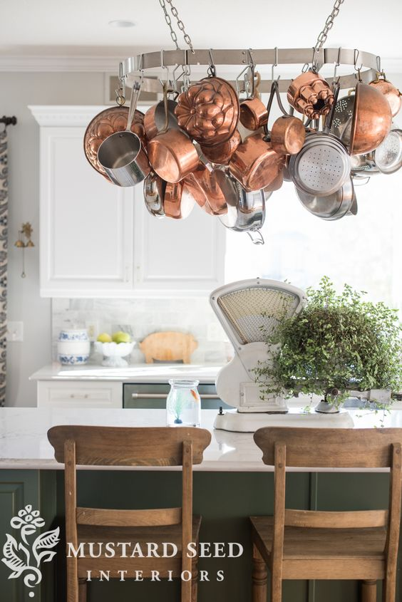 "For me the kitchen pot rack is very functional since most of my daily cookware hangs from it. The kitchen pot rack is one of those decorative touches that makes it feel like ""my kitchen"" 