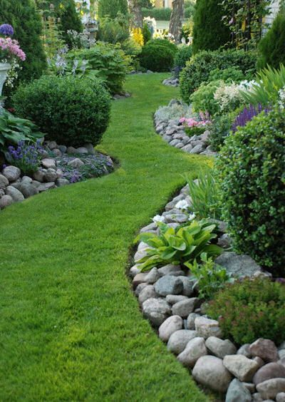 Natural path with rocks edging the border. This is going to be beautiful in my front yard.: