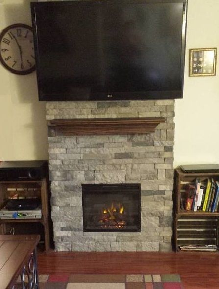 Love this stone but that tv is way too big for this for Fireplace half stone