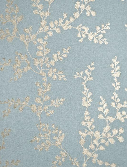Shadow Fern Floral Wallpaper Metallic gilver shadow fern print on marine blue wallpaper.