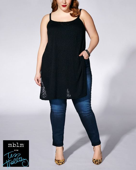 Make a statement in this sleek plus-size tunic from mblm by Tess Holliday! It has adjustable straps, sheer patterned over-layer with lining underneath and side slits. Wear it with a skinny jean or studded legging for a rockin' look.