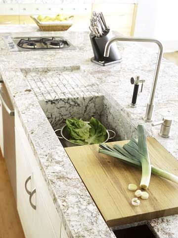 Oversize Sink with built-in cutting board and draining board.  All one flowing piece with the countertop.