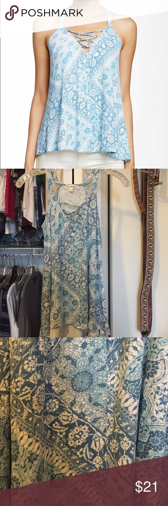 New blue floral tank! Super cute, brand new lace up tank! Wonderful stretchy material with an array of blues and whites. The neck line is unique and super flattering. love on a hanger Tops Tank Tops